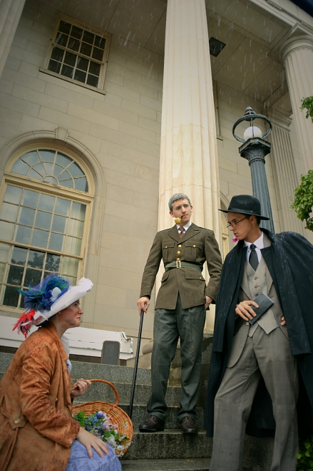 Camille Gray as Eliza Doolittle, James Altman as Colonel Pickering, and Benjamin Fitton as Henry Higgins
