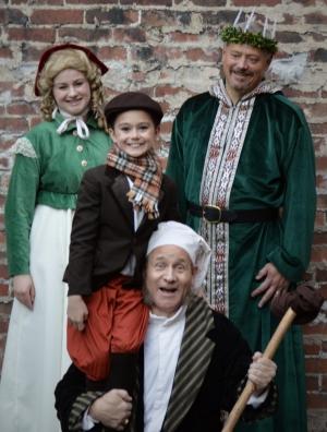 Theatre Bristol's Scrooge! The Musical: Christmas Past (Camille Gray), Tiny Tim (Olivia Stevens), Christmas Present (Michael Bishop), Scrooge (Steve Baskett).