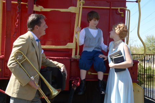 Theatre Bristol's The Music Man - Bob Cantler as Harold Hill, Zaiah Gray as Winthrop Paroo, and Kylie Green as Marian Paroo